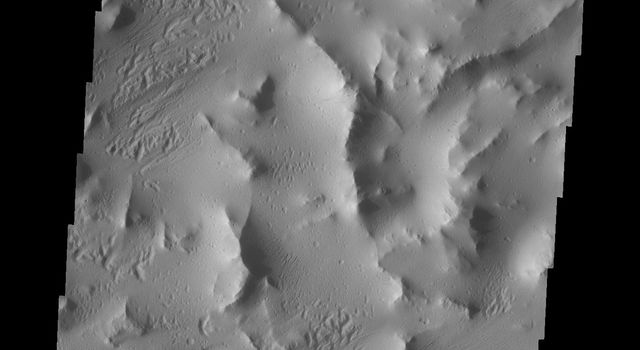 Dark slope streaks are common on the ridges of Lycus Sulci. These markings are thought to be formed by the removal of the brighter dust when material is shed from the top of the ridge. This image is from NASA's 2001 Mars Odyssey spacecraft.