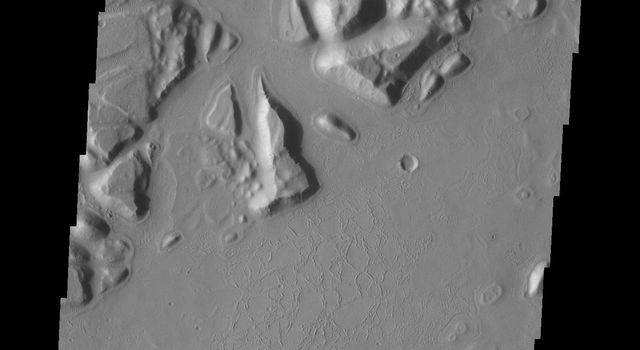 The hills and mesas in this image seen by NASA's 2001 Mars Odyssey spacecraft are part of Echus Chaos.