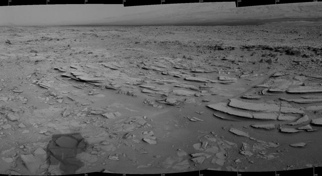 The NASA Mars rover Curiosity used its Navigation Camera (Navcam) during the mission's 120th Martian day, or sol (Dec. 7, 2012), to record the seven images combined into this panoramic view.