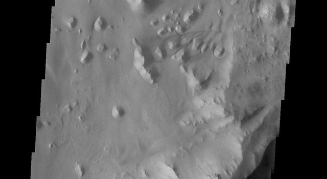 This image from NASA's 2001 Mars Odyssey spacecraft shows part of the floor of Ganges Chasma on Mars, including part of a sand sheet.