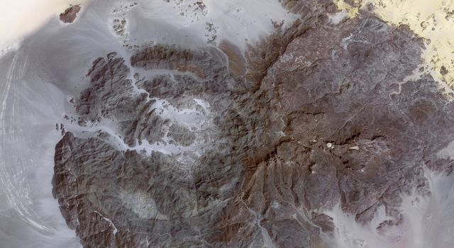 This image, acquired by NASA's Terra spacecraft on Mar. 17, 2012, is of Jebel Uweinat, a mountain range in the area of the Egyptian-Sudanese-Libyan border. It is reportedly one of the driest places on earth.