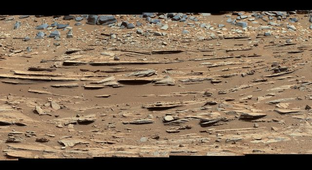 The 'Shaler' outcrop is dramatically layered, as seen in this mosaic of telephoto images from the right Mast Camera (Mastcam) on NASA's Mars rover Curiosity.