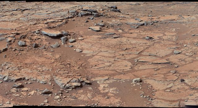 From a position in the shallow 'Yellowknife Bay' depression, NASA's Mars rover Curiosity used its right Mast Camera (Mastcam) to take the telephoto images combined into this panorama of geological diversity.