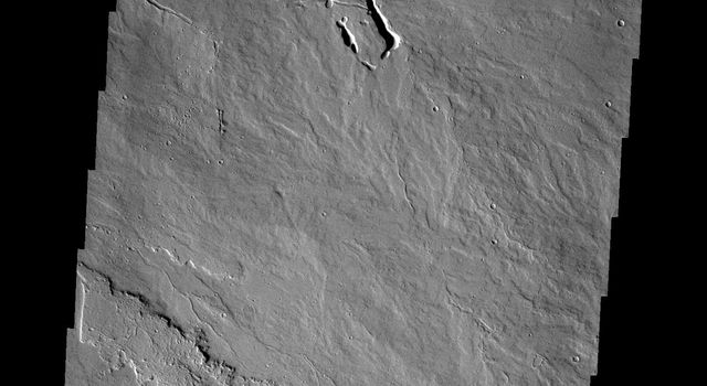 The lava flows and collapse features in this image from NASA's 2001 Mars Odyssey spacecraft are located near Ascraeus Mons on Mars.