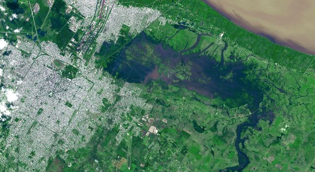 NASA's Terra spacecraft captured this view of severe flooding in La Plata, Argentina, on April 4, 2013. Torrential rains and record flash flooding has killed more than 50 and left thousands homeless, according to news reports.