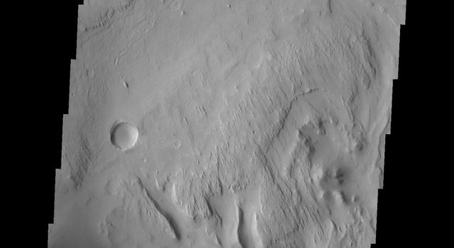 This image captured by NASA's 2001 Mars Odyssey spacecraft shows the region slightly south of yesterday's image, including the floor of the crater at the bottom of the frame.