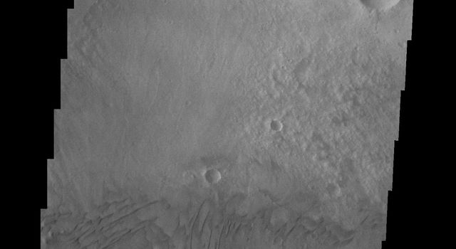 This image from NASA's Mars Odyssey spacecraft shows how close the dunes are to the Gale crater rim on Mars.