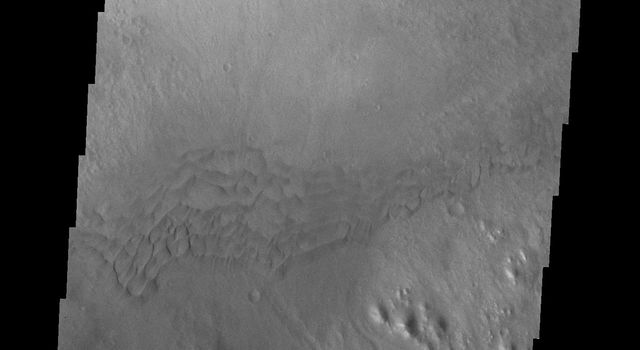 This image from NASA's Mars Odyssey spacecraft provides another look at one of the larger channels dissecting the rim of Gale Crater that may be the source of the dune material.