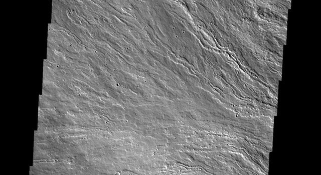 The lava flows in this image captured by NASA's 2001 Mars Odyssey spacecraft are located on Olympus Mons, the largest volcano in the solar system.