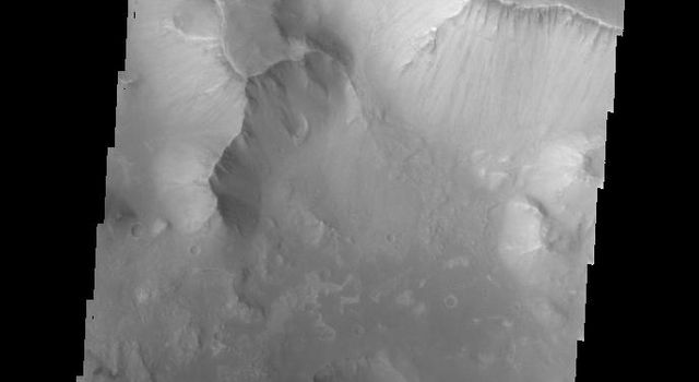 This image from NASA's Mars Odyssey spacecraft shows the eastern part of Hydrae Chasma.