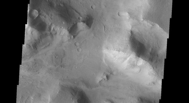 Do you see what I see in this image captured by NASA's 2001 Mars Odyssey spacecraft? One of the mesas in this image is heart shaped.