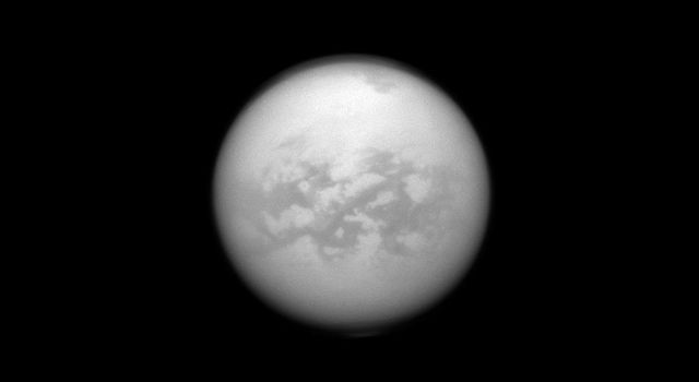 NASA's Cassini spacecraft uses special infrared glasses to peer through Titan's haze and monitor its surface inequatorial region dubbed 'Senkyo.' The dark features are believed to be vast dunes of hydrocarbon particles.