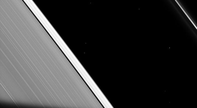 The shadow of Saturn cuts across the rings as seen by NASA's Cassini spacecraft. As the ring particles enter Saturn's shadow, their temperature drops to even colder temperatures, only to warm back up again when they re-emerge into the sunlight.
