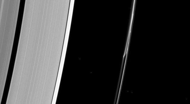 Saturn's F ring often appears to do things other rings don't. In this image from NASA's Cassini spacecraft, a strand of ring appears to separate from the core of the ring as if pulled apart by mysterious forces.