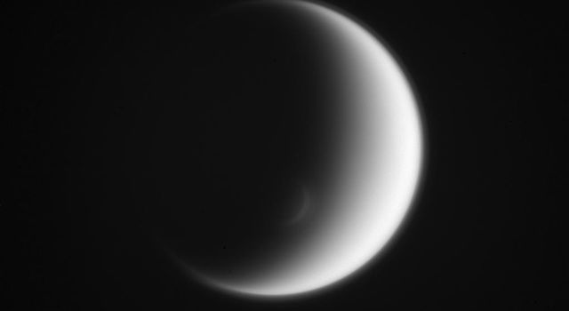 This view captured by NASA's Cassini spacecraft looks toward the trailing hemisphere of Titan. Titan's south polar vortex mimics the moon itself, creating an elegant crescent within a crescent.