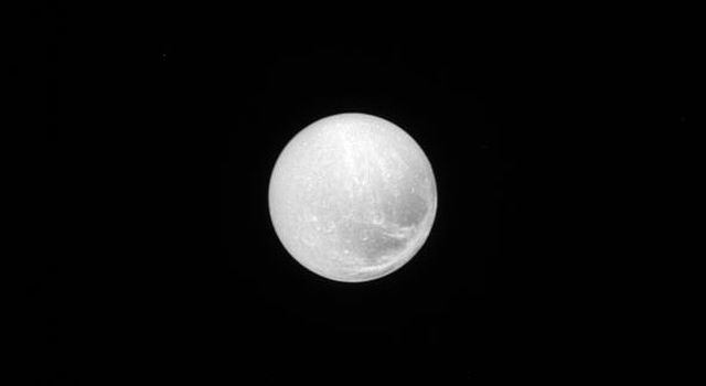 As seen by NASA's Cassini spacecraft, the surface of Dione is covered in craters, reminding us of the impacts that have shaped all of the worlds of our solar system; the surface also bears linear features that suggest geological activity in the past.