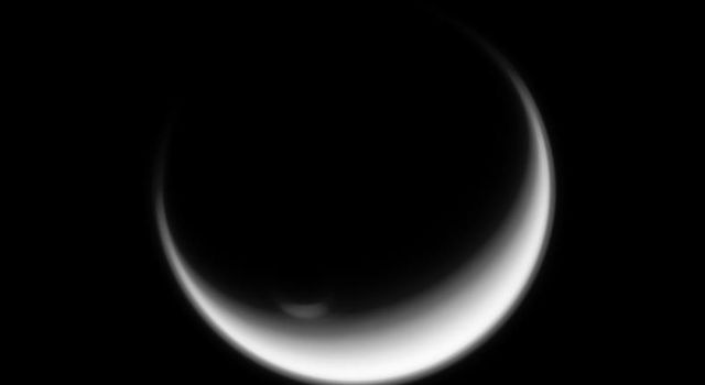Titan's polar vortex stands illuminated where all else is in shadow in this image from NASA's Cassini spacecraft.