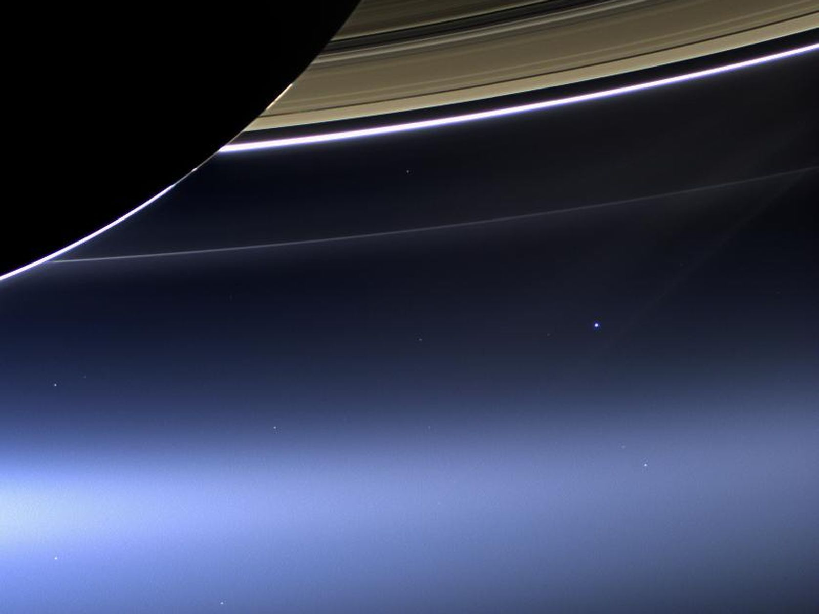 Saturn and the pale blue dot.