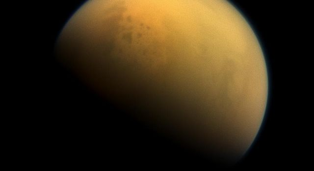Using a special spectral filter, NASA's Cassini spacecraft was able to peer through the hazy atmosphere of Saturn's moon Titan. This image features the largest seas and some of the many hydrocarbon lakes that are present on Titan's surface.