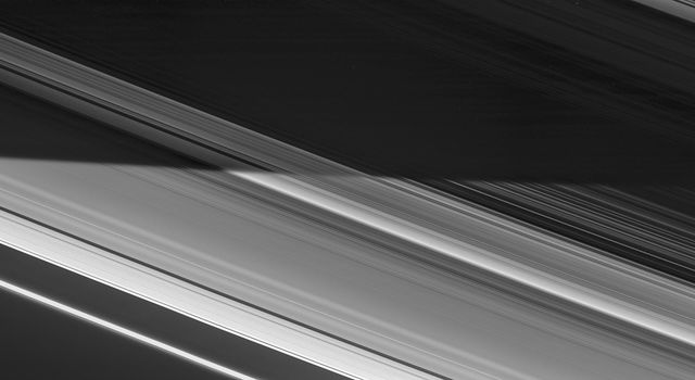 Saturn's shadow sweeps across the rings in a view captured on Nov. 5, 2006 by NASA's Cassini spacecraft. Countless icy particles that make up the rings bask in full daylight.