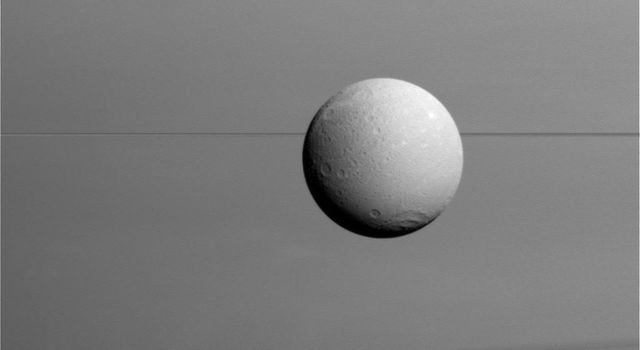 Dione with Rings and Shadows