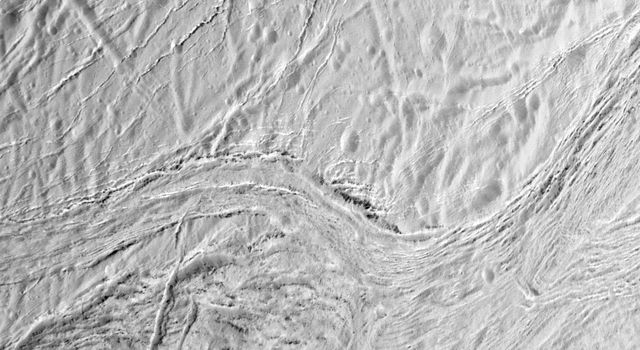 During its final close flyby of Saturn's moon Enceladus, NASA's Cassini orbiter shows this view featuring the nearly parallel furrows and ridges of the feature named Samarkand Sulci.