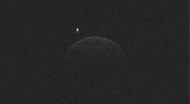 This radar imagery of asteroid 1998 QE2 and its moon was generated from data collected by NASA's 230-foot-wide (70-meter) Deep Space Network antenna at Goldstone, Calif., on June 1, 2013.