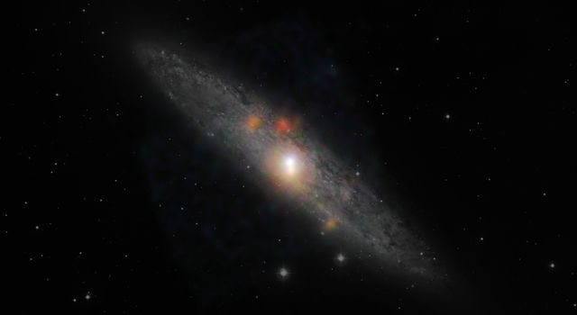 The Sculptor galaxy is seen in a new light, in this composite image from NASA's Nuclear Spectroscopic Telescope Array (NuSTAR) and the European Southern Observatory in Chile.