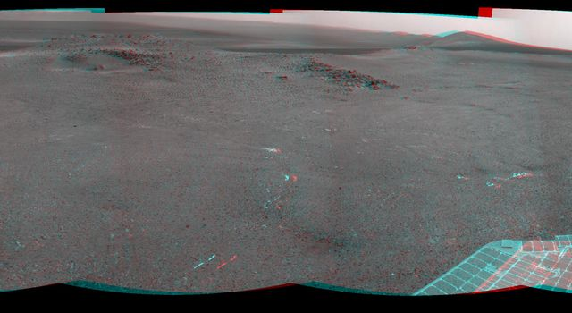 NASA's Mars Exploration Rover Opportunity recorded this 3D view of a rise called 'Nobbys Head' during a stop on a multi-week southward drive between two raised segments of the west rim of Endeavour Crater.