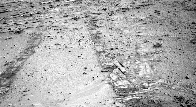 This view from the left Navigation Camera (Navcam) of NASA's Mars Rover Curiosity looks back at wheel tracks made during the first drive away from the last science target in the 'Glenelg' area.