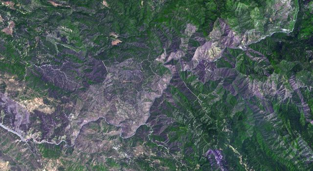 This image, acquired by NASA's Terra spacecraft, is of the Carstens, Calif. wildfire which continues to burn in the foothills west of Yosemite National Park. Vegetation is displayed in green and burned and bare areas are dark to light gray.