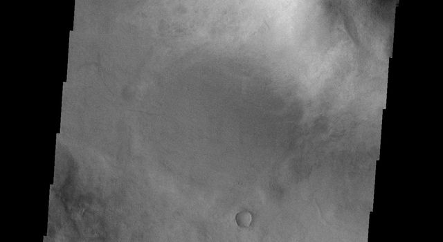 This image from NASA's Mars Odyssey spacecraft shows what looks like a smiley face on the surface of Mars.