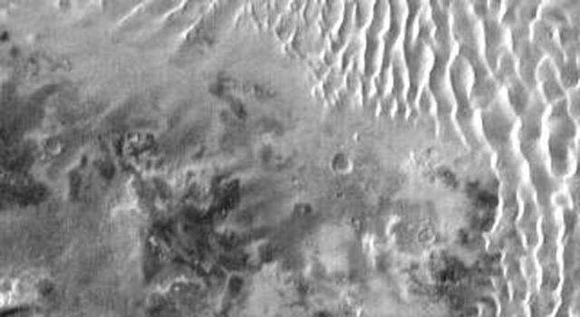 This daytime IR image from NASA's Mars Odyssey spacecraft shows part of the dune field on the floor of Kaiser Crater. The dune sand is warmer than the surrounding materials, so it appears bright in the IR image.