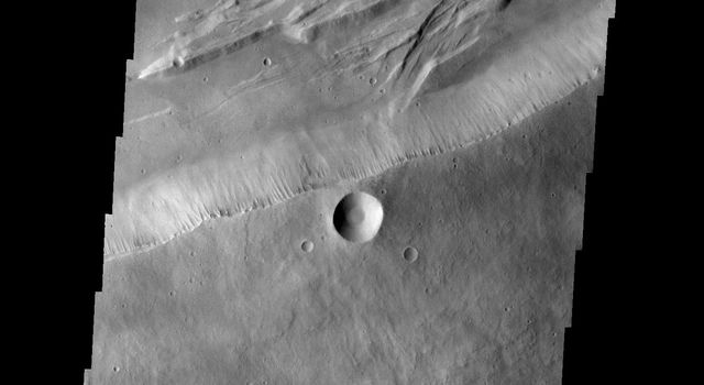 This image from NASA's 2001 Mars Odyssey spacecraft shows part of the summit caldera on Arsia Mons.