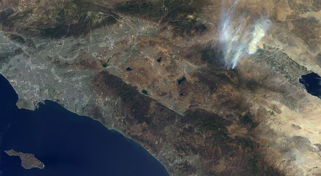 NASA's Terra spacecraft passed over the Mountain Fire near Idyllwild, Calif., on Jul. 17, 2013. Los Angeles and the Pacific Ocean can been seen to the left and the Salton Sea is the dark feature in the right center of the image.