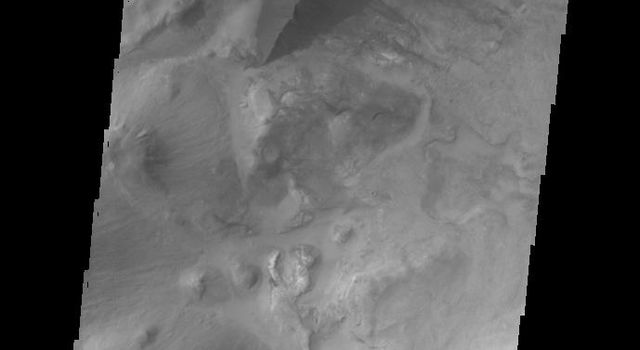 The large hills of sand in this image from NASA's 2001 Mars Odyssey spacecraft are located on western margin of Argyre Planitia on Mars.