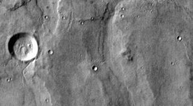 This daytime IR image captured by NASA's 2001 Mars Odyssey spacecraft shows part of the patera (summit depression) and eroded flank of Hadriacus Mons at the top of the image and a section of Dao Vallis at the bottom of the image.