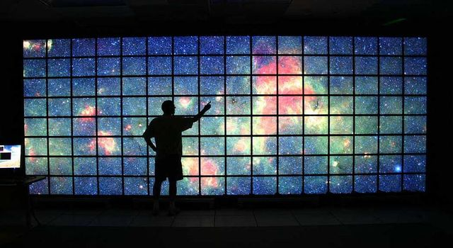 The center of the Milky Way galaxy imaged by NASA's Spitzer Space Telescope is displayed on a quarter-of-a-billion-pixel, high-definition 23-foot-wide (7-meter) LCD science visualization screen at NASA's Ames Research Center.