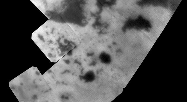 The vast hydrocarbon seas and lakes (dark shapes) near the north pole of Saturn's moon Titan sprawl out beneath the watchful eye of NASA's Cassini spacecraft. Scientists are studying images like these for clues about how Titan's hydrocarbon lakes formed.