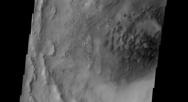 This image captured by NASA's 2001 Mars Odyssey spacecraft shows the dunes on the floor of Bogia Crater, a crater in Hellas Planitia.