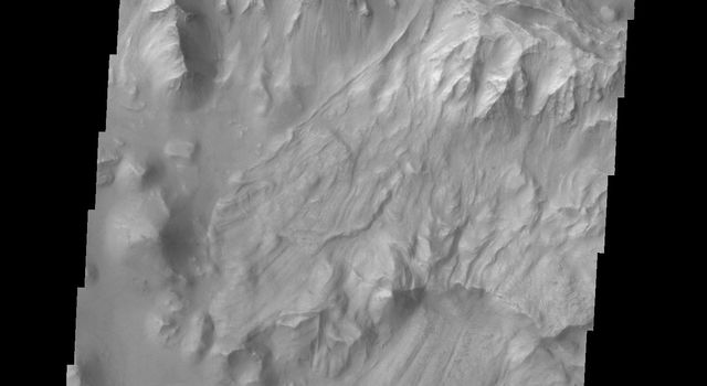 Several landslides occurred on this steep cliff face in this image captured by NASA's 2001 Mars Odyssey spacecraft.