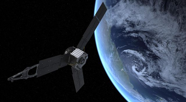 This artist's rendering shows NASA's Juno spacecraft during its Earth flyby gravity assist on Oct. 9, 2013. On Earth below, the southern Atlantic Ocean is visible, along with the coast of Argentina.