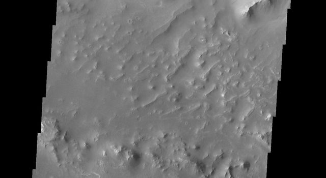 The landslide deposits in this VIS image from NASA's 2001 Mars Odyssey spacecraft are located in Valles Marineris and are called Coprates Labes.