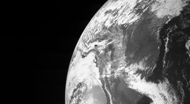 On Oct. 9, NASA's Juno spacecraft flew past Earth, using our home planet's gravity to get the final boost it needed to reach Jupiter. The JunoCam instrument captured this monochrome view of Earth.