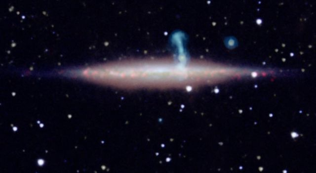 New detailed radio data from the NRAO's Jansky Very Large Array (VLA) revealed that the large perpendicular extension of UGC 10288's halo (blue) is really a distant background galaxy with radio jets.