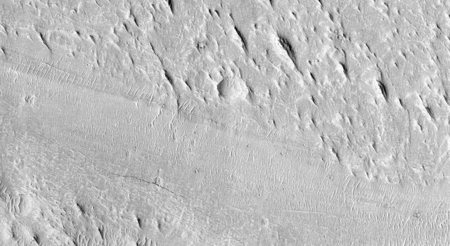 Shown here is an exceptionally long sinuous ridge, possibly an inverted fluvial feature, that cuts across newly mapped geologic units of the Medusae Fossae Formation, from NASA's Mars Reconnaissance Orbiter.