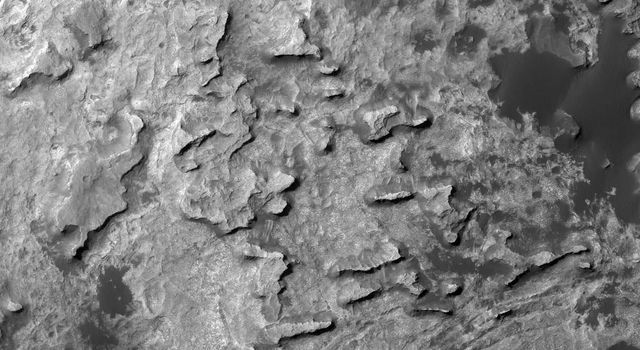 This view taken from orbit shows a cluster of small, steep-sided knobs called 'Murray Buttes,' in tribute to Bruce Murray (1931-2013), an influential advocate for planetary exploration.
