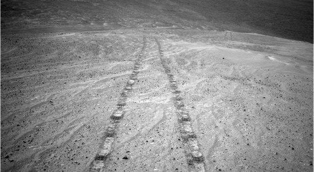 NASA's Mars Exploration Rover Opportunity captured this image as the rover ascended 'Murray Ridge' above 'Solander Point' on the western rim of Endeavour Crater.