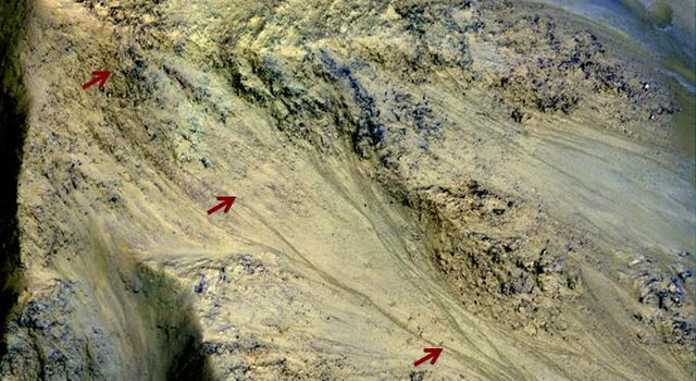 This image from NASA's Mars Reconnaissance Orbiter includes an especially long example of a type of dark marking that advances down some Martian slopes in warmer months and fades away in cooler months.
