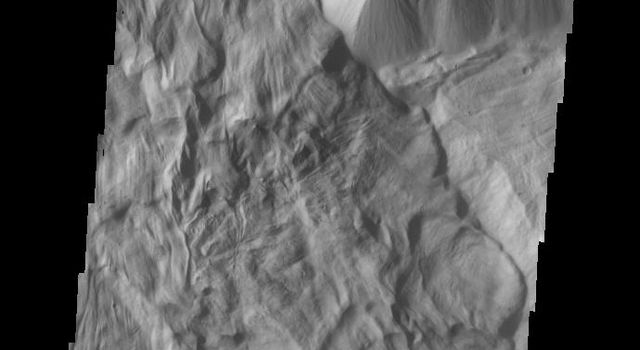 This image of Ophir Chasma shows part of a large landslide deposit as seen by NASA's 2001 Mars Odyssey spacecraft.